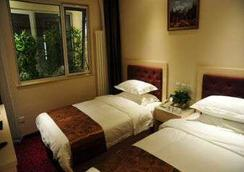 Super 8 Hotel Beijing Bei Hai Park West Gate - Beijing - Bedroom