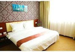 Super 8 Hotel Nantong Hai an Yong An Bei Lu - Nantong - Bedroom
