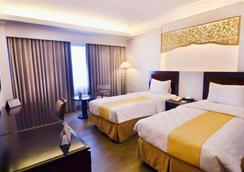 Kyriad Hotel Bumiminang - Padang - Bedroom