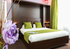Hôtel Le Rocroy - Paris - Bedroom