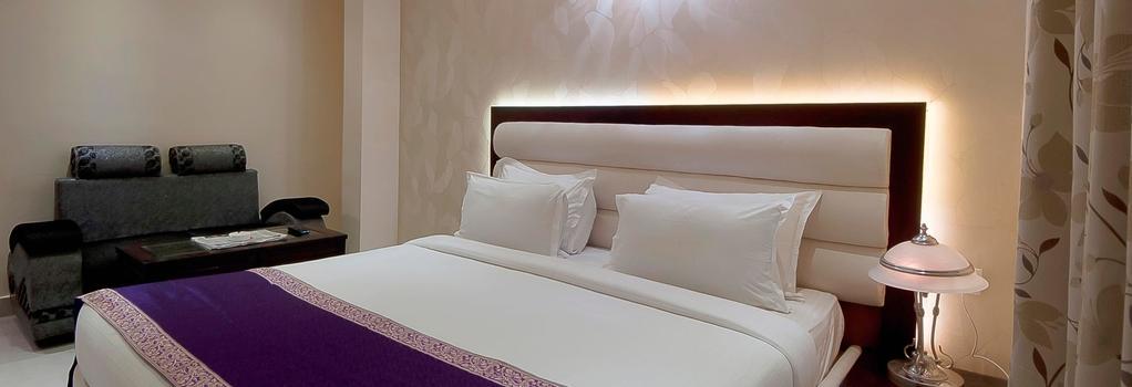 Central Residency Hotel - Varanasi - Bedroom