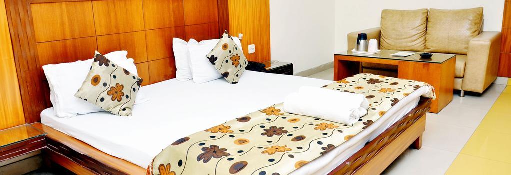 Hotel Mandakini Plaza, Kanpur - Kanpur - Bedroom