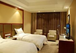 GreenTree Eastern Quzhou Hewu Road Hotel - Quzhou - Bedroom