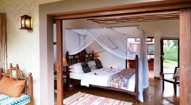Neptune Palm Beach Boutique Resort & Spa - Ukunda - Bedroom