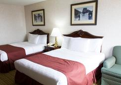 GuestHouse Inn & Suites Sioux Falls - Sioux Falls - Bedroom