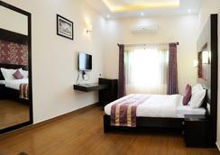 Oriole Resorts - Mysore - Bedroom