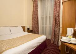 Reem Hotel - London - Bedroom