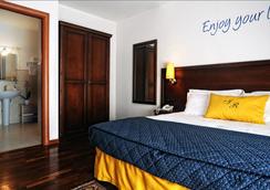 Inn Rome Rooms & Suites - Rome - Bedroom