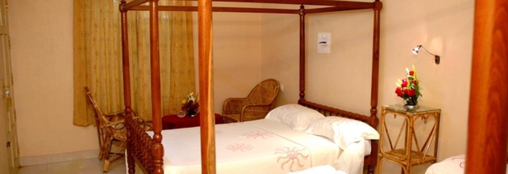 Ideal Ayurvedic Resort - Thiruvananthapuram - Bedroom