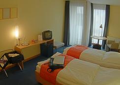 Hotel Aquino Tagungszentrum - Berlin - Bedroom