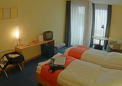 Hotel Aquino Tagungszentrum - Berlin - Bedroom