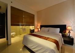 Emilia Hotel by Amazing - Palembang - Bedroom