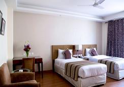 Alpina Hotels & Suites - New Delhi - Bedroom