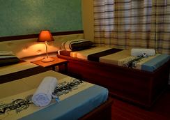 Julieta's Pension House - Puerto Princesa - Bedroom