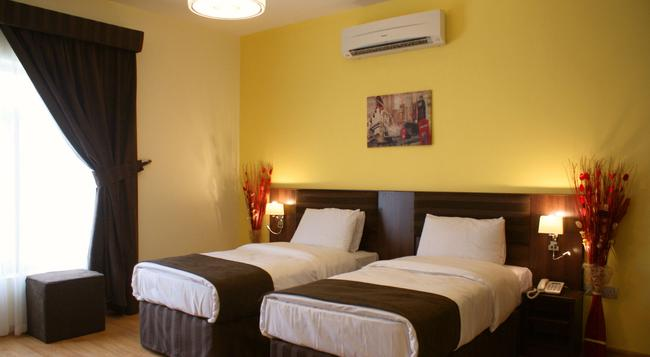 Weekend Hotel Apartments - Muscat - Bedroom