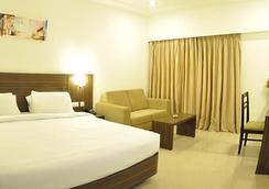 Hotel Midcity - Vijayawada - Bedroom