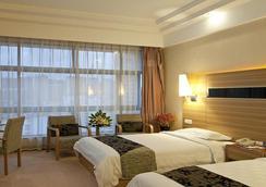 Herton Hotspring Hotel - Kunming - Bedroom