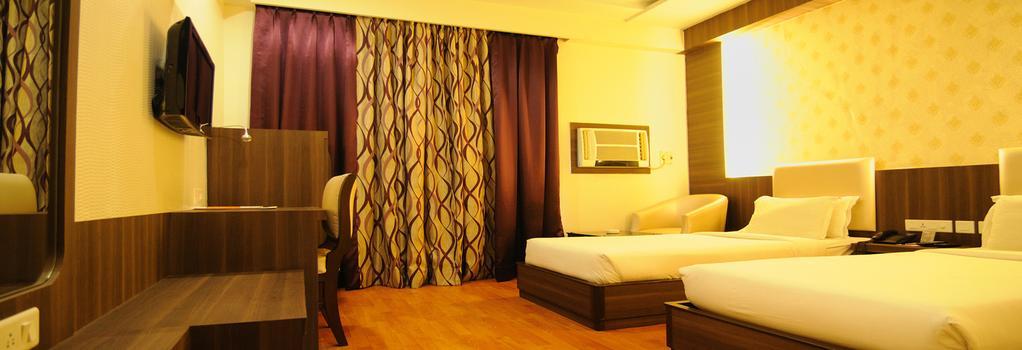 Hotel The Sojourn - Kolkata - Bedroom