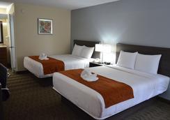 Days Inn & Suites Orlando Airport - Orlando - Bedroom