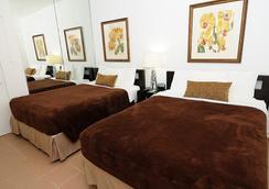 Tres Palmas Inn - San Juan - Bedroom