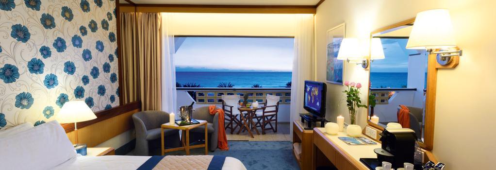 Constantinou Bros Athena Royal Beach Hotel - Paphos - Bedroom