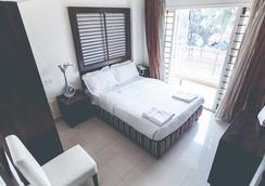 Royal Suites Hotel Apartments - Bangalore - Bedroom