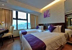 The Bauhinia Hotel - Tsim Sha Tsui - Hong Kong - Bedroom