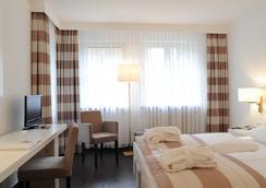 Relexa Waldhotel Schatten - Stuttgart - Bedroom