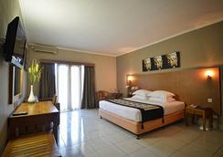 Taman Rosani Hotel - Kuta (Bali) - Bedroom