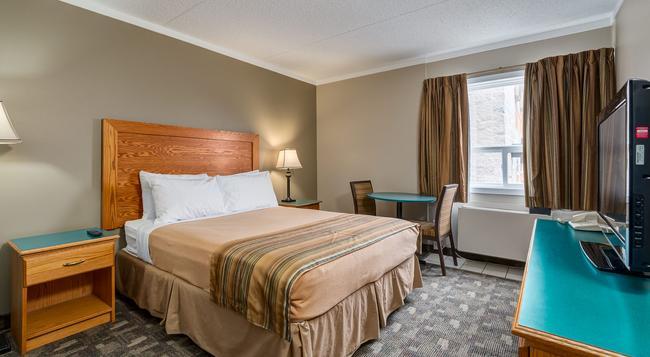 Airport Traveller's Inn - Calgary - Bedroom