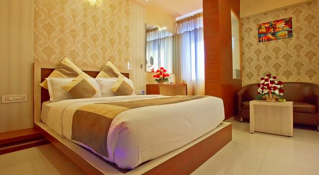 Aishwarya Suites - Mysore - Bedroom